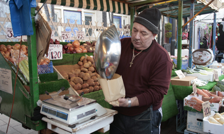 Greengrocer on his stall, Broadway Market Photo: © The Hackney Citizen Ltd