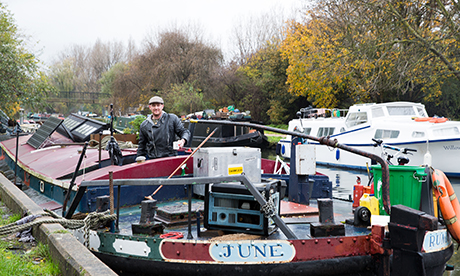 Damian Walsh on his boat 'June' currently moored in Lower Clapton. Photograph: Eleonore de Bonneval