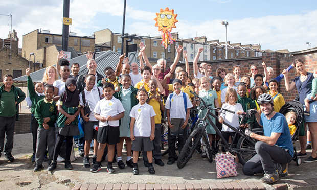 Blame it on the sunshine: Campaigners, parents and pupils celebrate decision. Photograph: Bex Wade