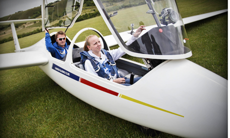 Though the flying scholarship was open to all students between 16 and 18 at the mixed school, the chosen eight were all female