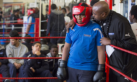 Pupils at The Boxing Academy in Hackney, London attend a boxing class. The Academy take children who are close to exclusion and teaches them normal subjects with an added emphasis on boxing sport and boxing training. London, U.K., on Friday, Feb. 7, 2014. Photographer: Jason Alden for The Independent on Sunday Photographer: Jason Alden for The Independent www.jasonalden.com 0781 063 1642