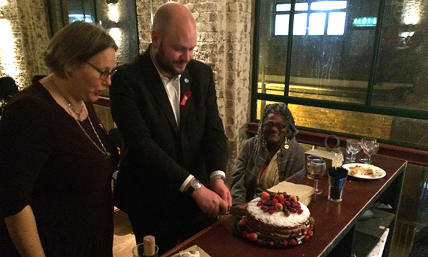 Hackney's mayor Philip Glanville cuts the cake at Immediate Theatre's 20th anniversary party