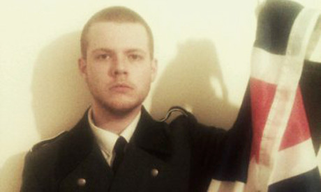 Joshua Bonehill in uniform with flag 460 x 276