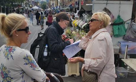 Collecting signatures at Hoxton Market