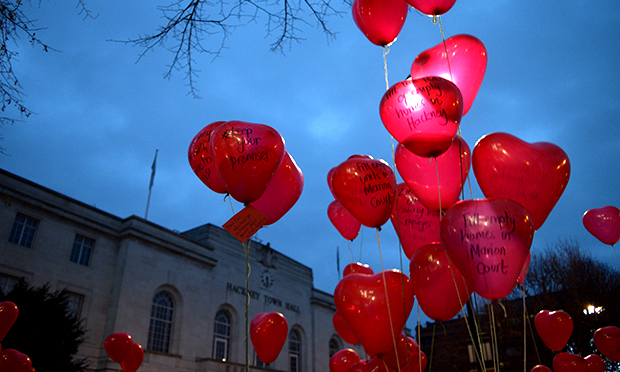Red heart balloons outside the Town Hall