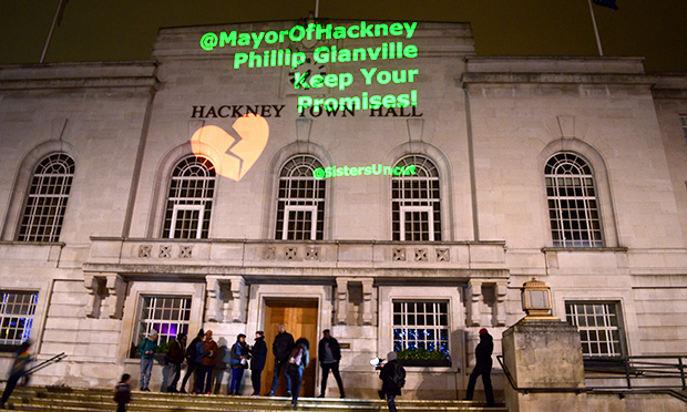 Sisters Uncut project message onto Town Hall