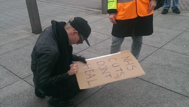 Stik signs a fan's placard. Photograph: Hackney Citizen