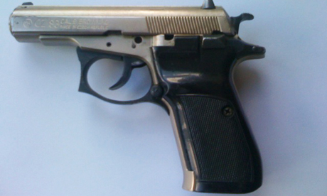 The semi-automatic pistol discovered in Woods bag