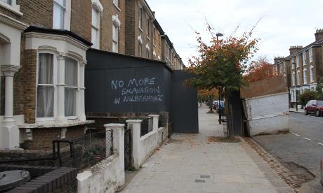 No more: Graffiti on the hoardings outside number 90. Photograph: Ella Jessel