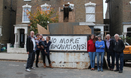 Enough: Residents of Wilberforce Road outside an excavation at number 90. Photograph: Ella Jessel