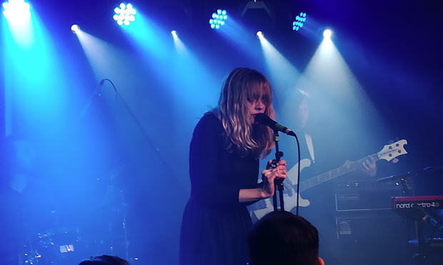 """Alexandra Saviour """"theatrically cowering down behind the mic. Photograph: Casey Cooper-Fiske"""