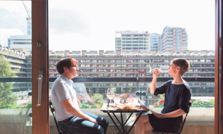 Comfortable: estate residents dine out on their balcony. Photograph: Anton Rodriguez