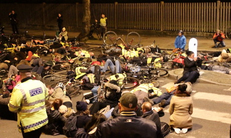 Demonstrators lie in the road for two minutes at vigil for cyclist Stephanie Turner. Photograph: Ella Jessel