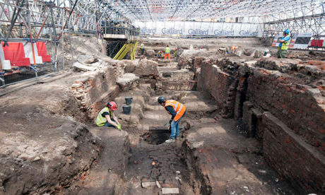 Archeologists excavating the site of The Curtain Theatre