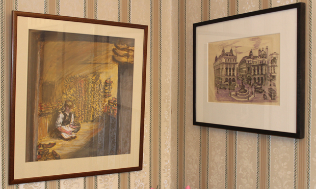 The original of Piccadilly Circus (right) hangs on Gosnell's Woodberry Down flat