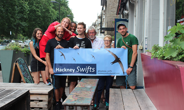 Hamish Burnett (far-right) and supporters gathered outside e Star by Hackney Downs pub - which has swift boxes in situ. Photograph: Andrew Barnes