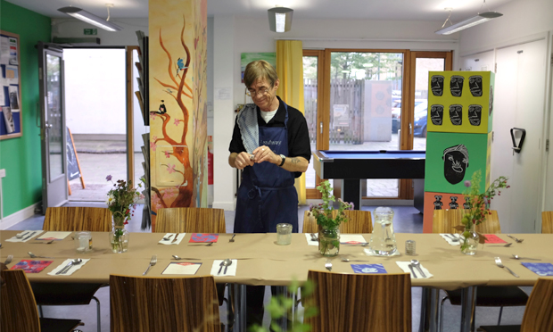 Silver service: Headway East London member Daniel hard at work setting up for one of their popular supper clubs. Photograph: Headway East London