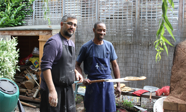 Cook-out: Headway East London's Zuber Haji and brain injury survivor Keith share bread-making duties. Photographs: Jade King