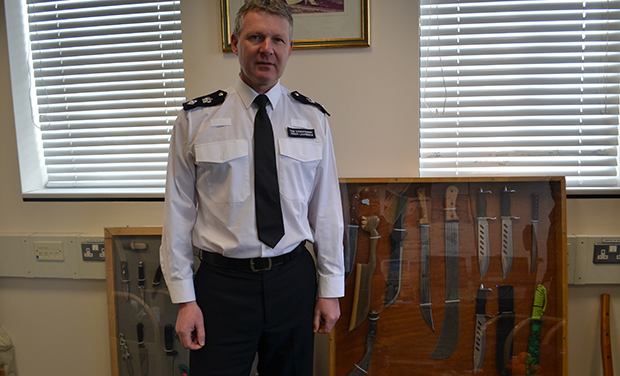 Hackney's borough commander in his office at Stoke Newington Police Station - with a cabinet of knives taken off the streets by police