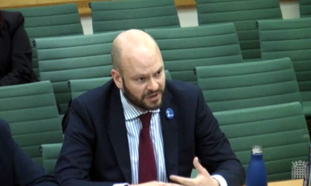 Mayor Glanville, with a reuseable water bottle, speaks at the waste inquiry. Photograph: Parliament.uk