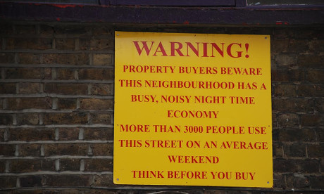 Sign on Rivington Street warning potential buyers.