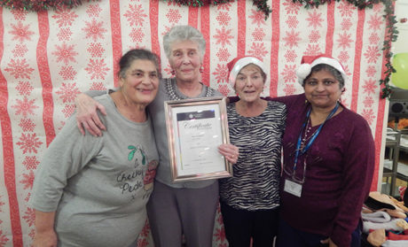 Sheila Bryant, a volunteer who received an award in December 2016 for 25 years service, pictured at a festive party alongside others who volunteer at the hospice