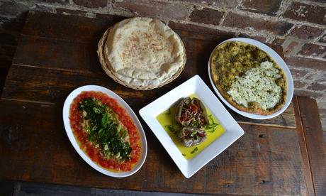 Makdoos, foul and mana'eesh with cheese and zataar served with Levantine bread